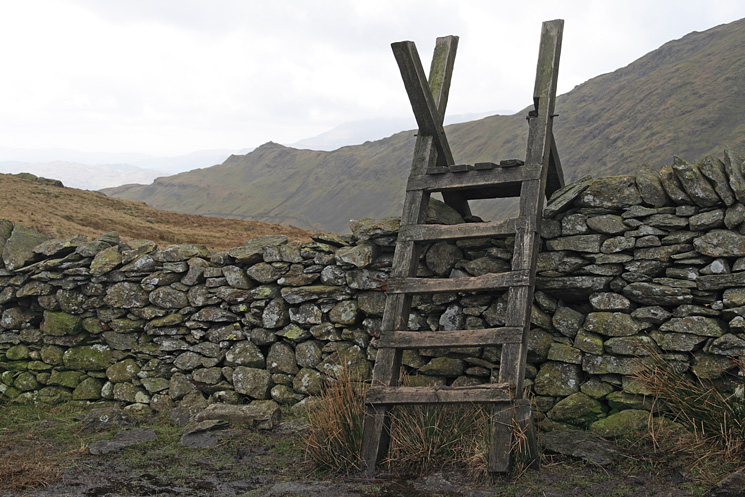 The ladder stile over the wall at Scandale Pass with Low Pike on the left