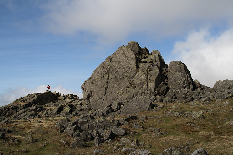 Harter Fell's summit rocks with David standing by the trig point