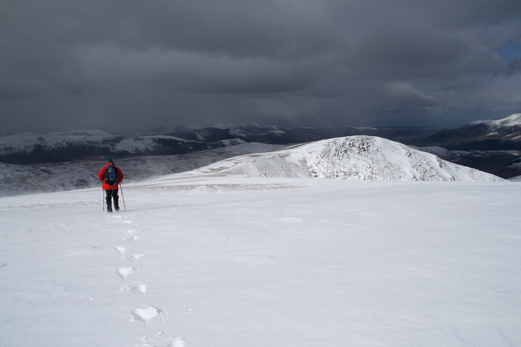 Heading for Helvellyn Lower Man with the north western fells getting some weather