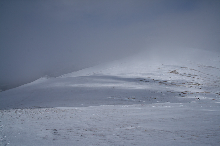 Calfhow Pike and the snow and cloud start to clear again