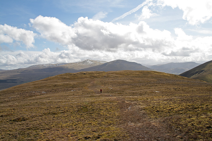 Leaving Souther Fell's summit, Clough Head in shadow and Great Dodd in sun
