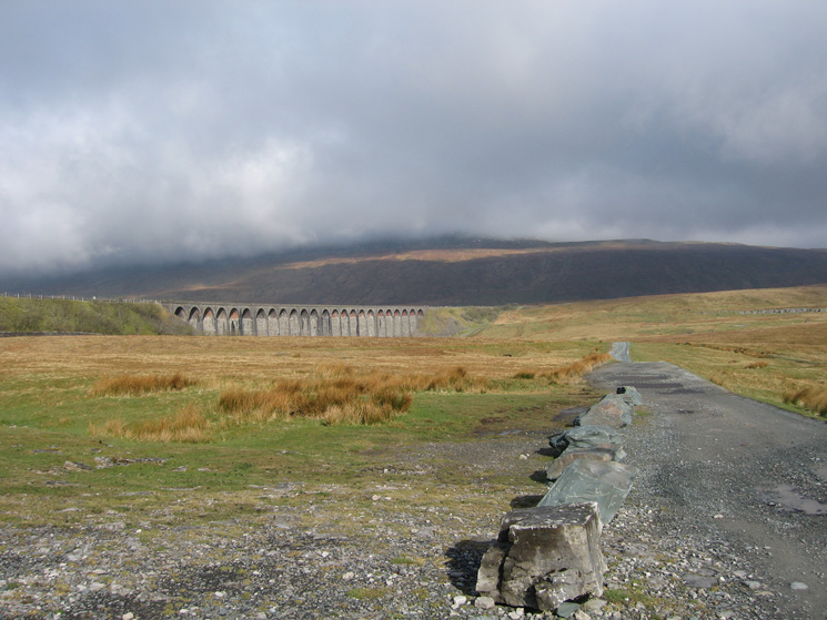 Ribblehead Viaduct with Whernside in cloud behind