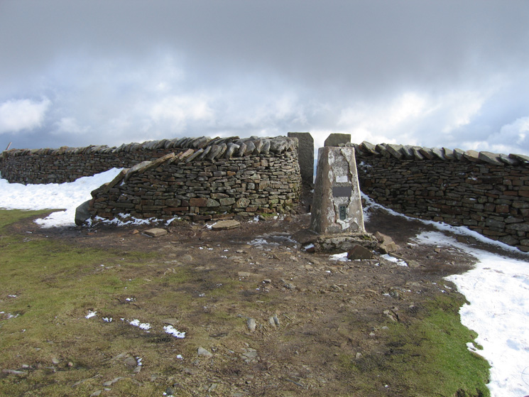 Whernside's trig point, actually on the other side of the wall to the main ridge path