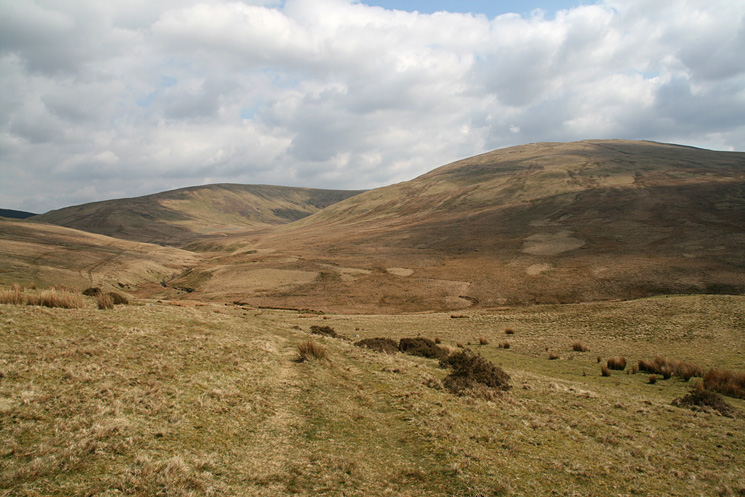 Looking back to Whoap on the left and Lank Rigg as we head for the Coldfell Road
