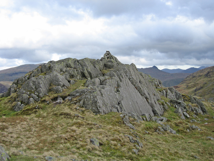 Bessyboot summit with the pointed top of Pike o'Stickle in the distance
