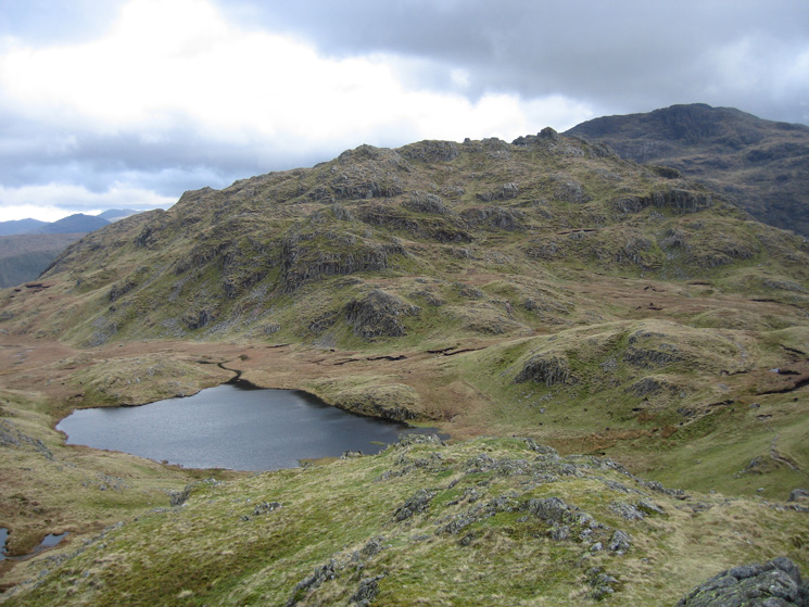 Looking over Tarn at Leaves to the higher southern part of Rosthwaite Fell with Combe Head behind right from Bessyboot's summit