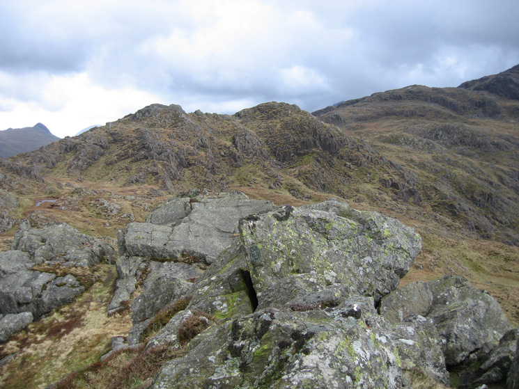The twin tops of Rosthwaite Fell - Dovenest Crag top (called Stonethwaite Fell by Bill Birkett) with Combe Door Top on the right from Rosthwaite Cam