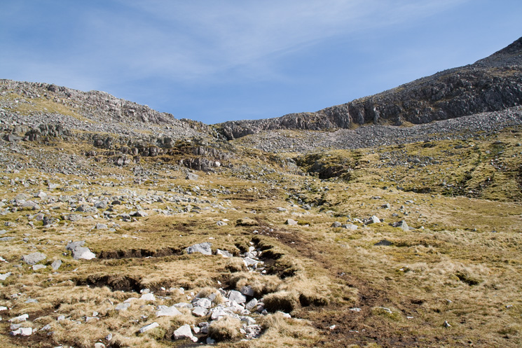 The stream is crossed and the small rock band climbed (easy) on the route to the ridge