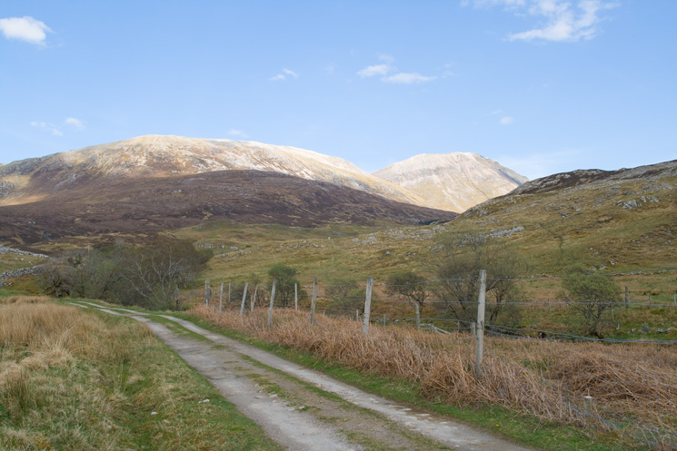 Conival in sunshine on the right from near Inchnadamph