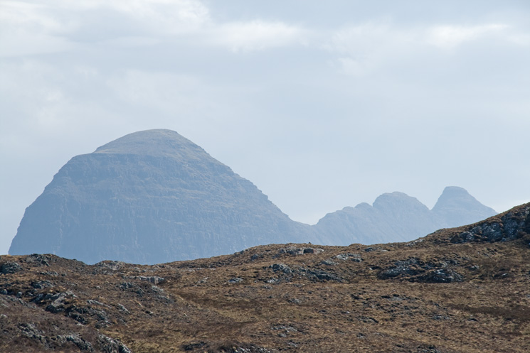 Just before you reach the falls you catch sight of the top of Suilven