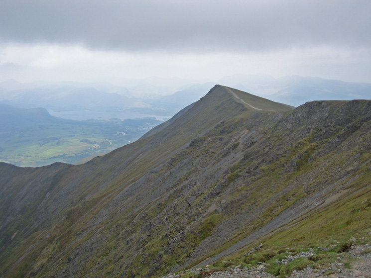 Gategill Fell Top with Derwent Water and the north western fells beyond lost in the haze / cloud