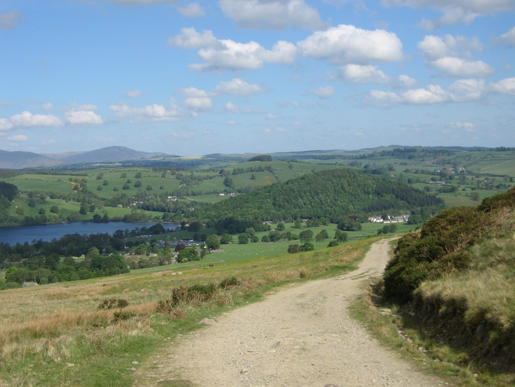 The foot of Ullswater and the wooded Dunmallard Hill (referred to as Dunmallet by AW) from the track above Roehead
