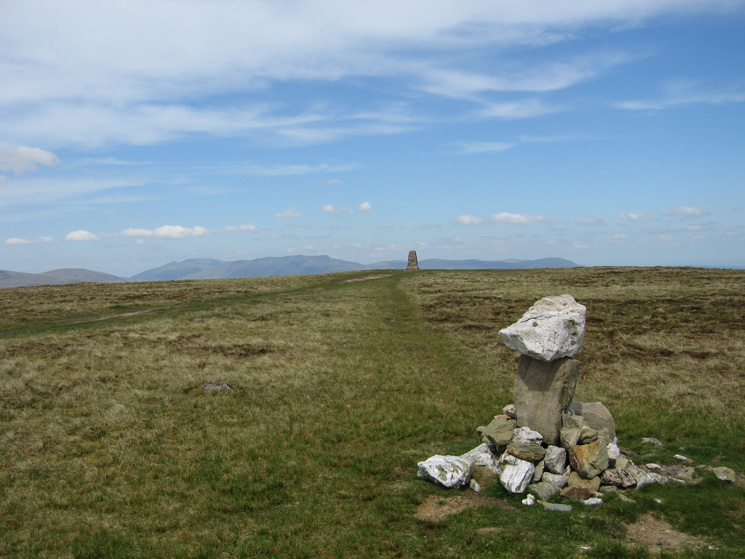 Loadpot Hill summit, the cairn including a boundary stone is at the 672m spot height and the trig point at 671m