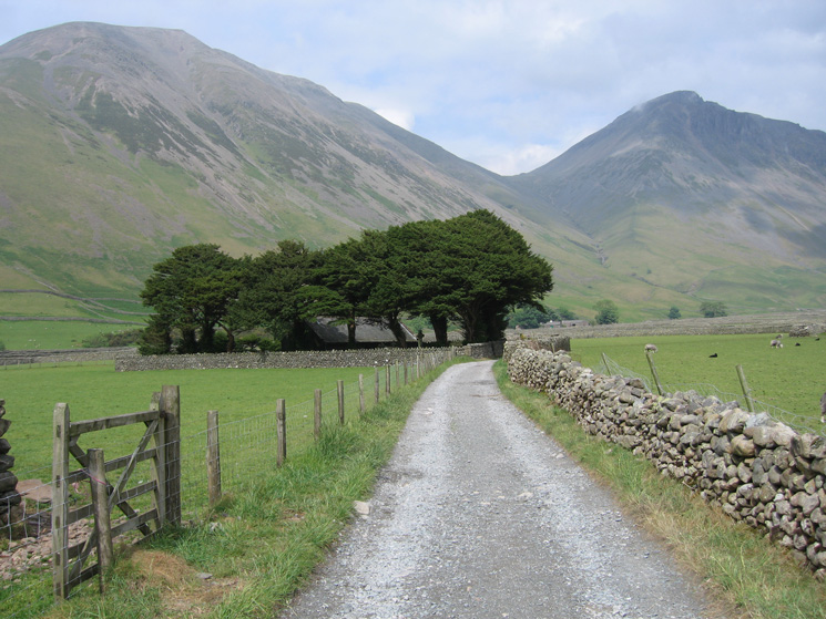 Kirk Fell and Great Gable with St Olaf's Church, Wasdale Head in the trees