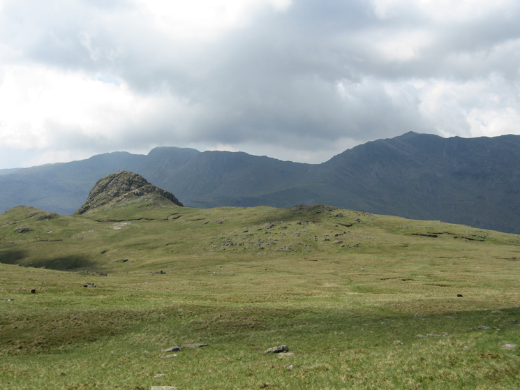 Looking back to Pike o'Stickle with Crinkle Crags and Bowfell in shadow behind