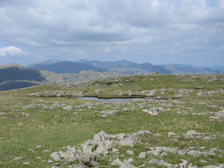 The north western fells from Thunacar Knotts summit, Wainwright's top can be seen on the far side of the tarn