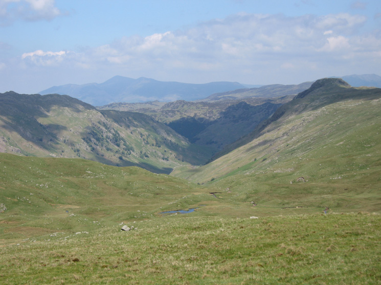 Langstrath with Rosthwaite Fell on the left, Sergeant's Crag on right and Skiddaw in the distance from Martcrag Moor