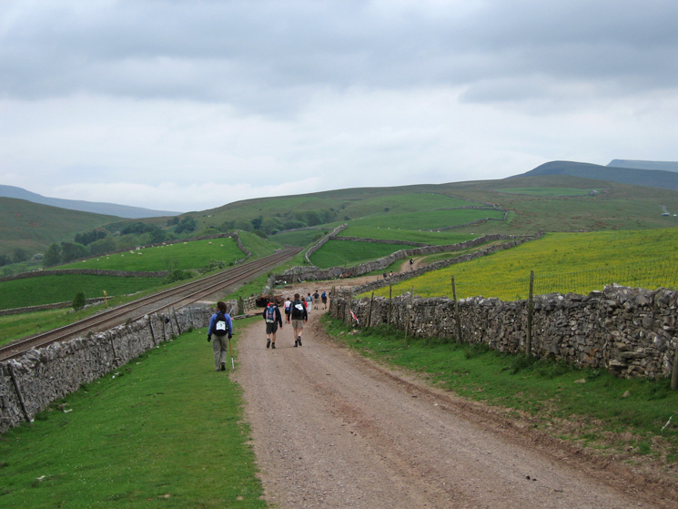 The Settle to Carlisle railway line with The Nab (Wild Boar Fell) in the distance (right)
