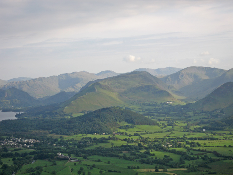 Zooming in on the wooded Swinside with Catbells, Maiden Moor and High Spy behind