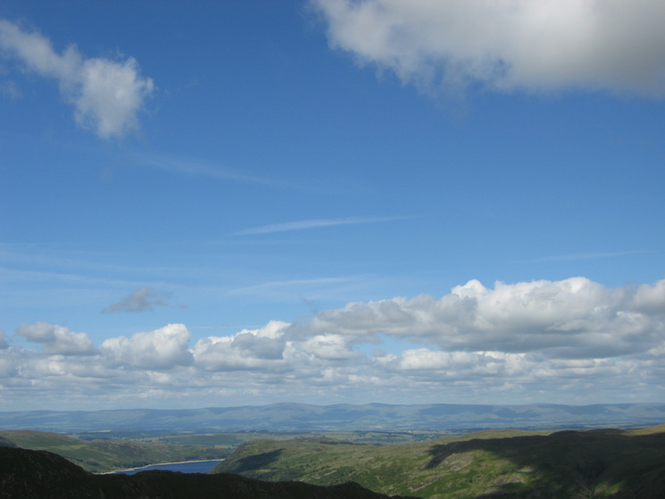 Blue skies over the Vale of Eden with the North Pennines in the distance