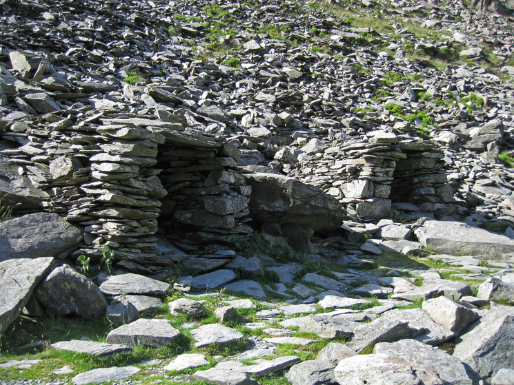 Two of the three stone shelters at Small Water
