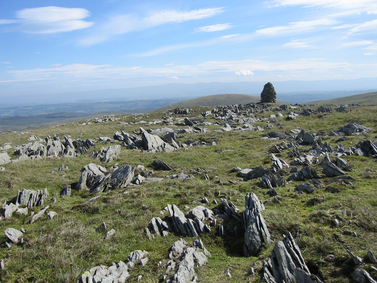 The higher cairn on Artle Crag with the rounded Selside Pike beyond and the North Pennines in the distance