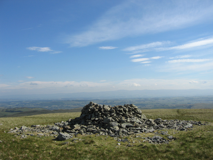Selside Pike's summit cairn with the North Pennines in the distance