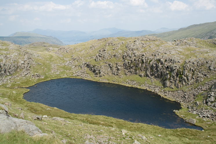 Sprinkling Crag Tarn also called Great Slack Tarn