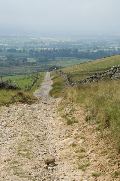 The track down to Dufton, the Lake District is lost in the heavy haze