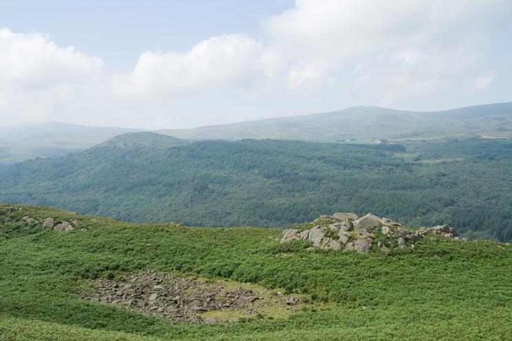 Looking over Wainwright's bouldery tarn (dry) to Penn (near ridge) and Buck Barrow