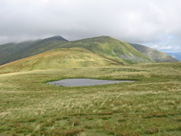 Buck Pike, Brown Pike and Walna Scar from the small tarn near White Maiden's summit