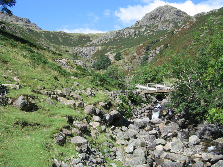 Footbridge over Stickle Ghyll with Tarn Crag on the skyline right