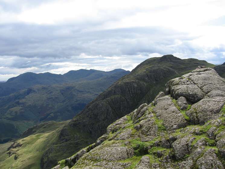 Pavey Ark's summit, looking towards Harrison Stickle with the Coniston Fells beyond