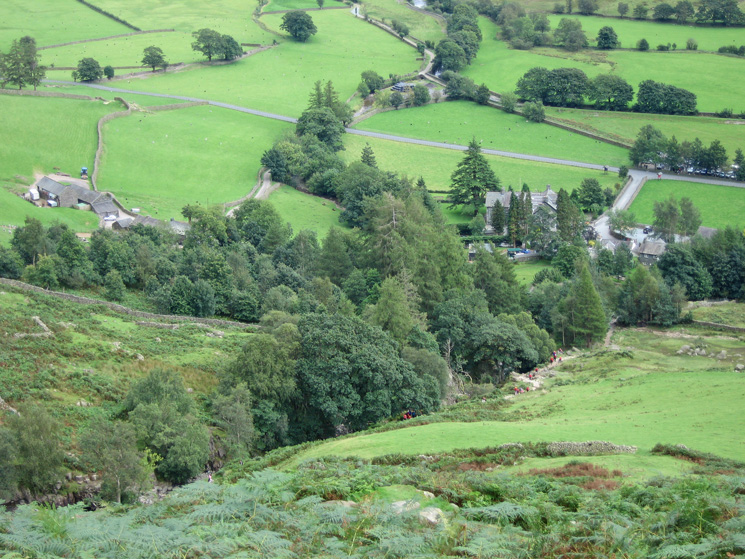 Looking down on the New Dungeon Ghyll Hotel in the trees and Millbeck on the left