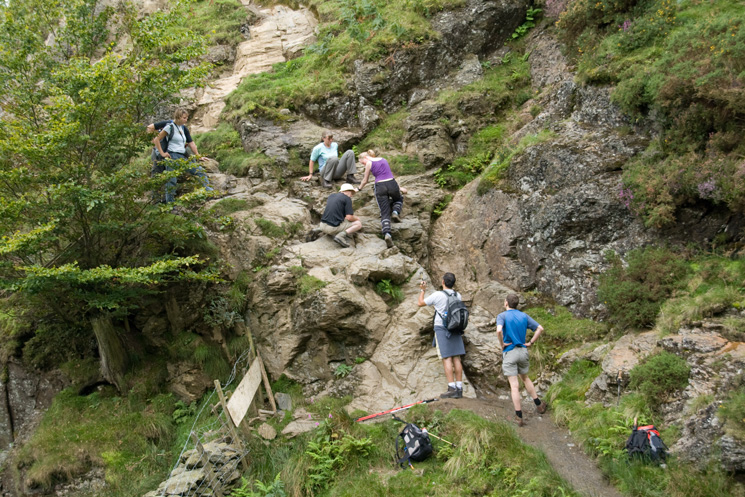 Traffic jam on the short rock step at Scaley Beck on the under Blencathra path