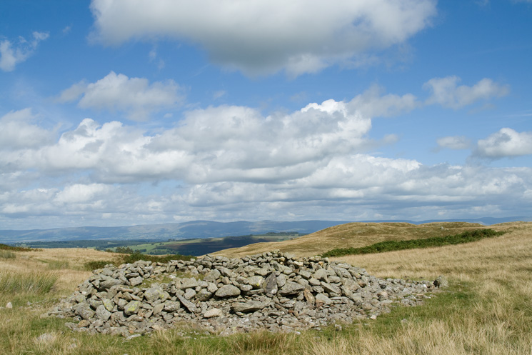 Prehistoric round cairn next to Four Stones Hill
