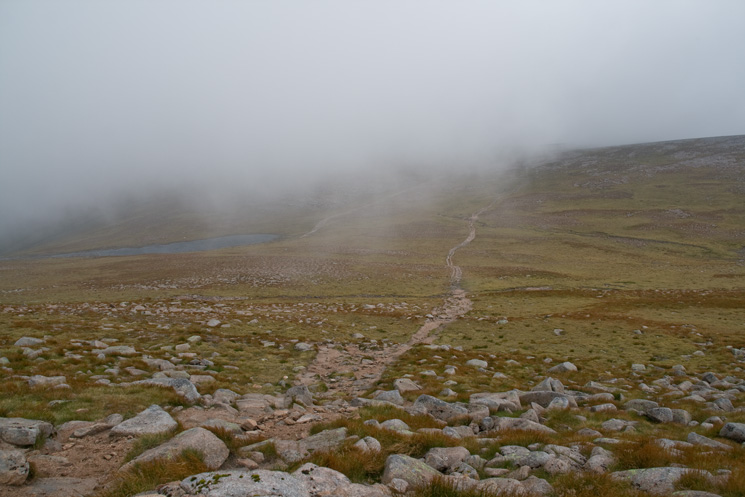 Looking back to Ben Macdui in cloud with Lochan Buidhe on the left