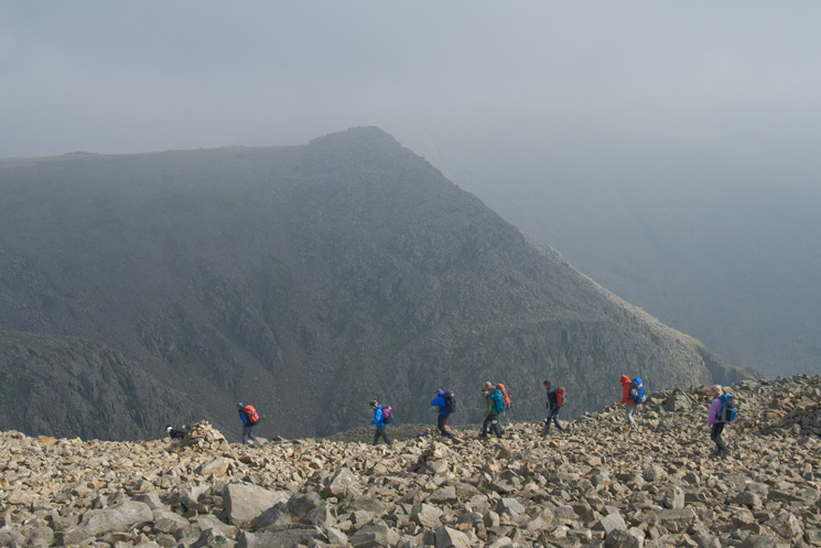 Walkers descending to Broad Crag col with Ill Crag beyond