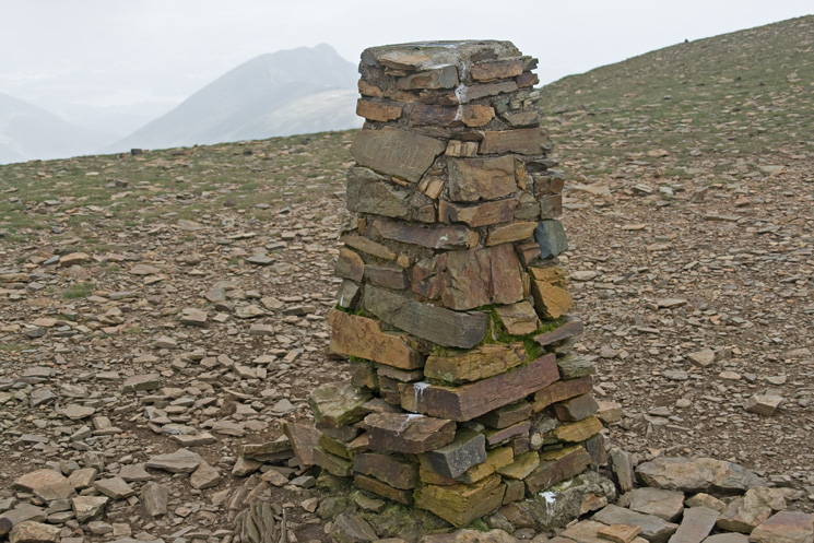 A sad looking trig point at Crag Hill's summit
