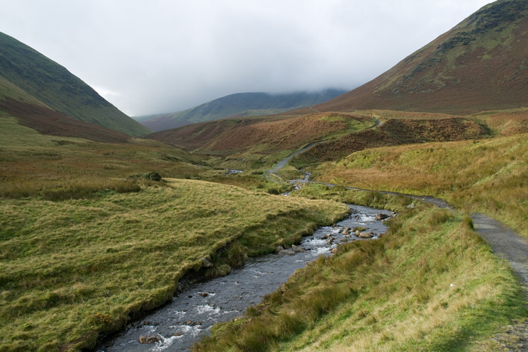 The Tongue on the right with the top of Bannerdale Crags in cloud in the distance from next to the River Glenderamackin