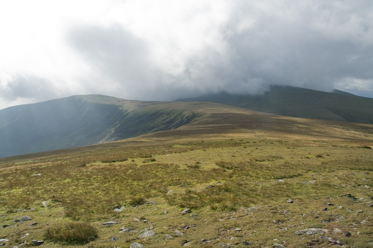 Bannerdale Crags from Bowscale Fell with Blencathra in cloud on the right