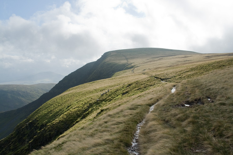 The crag top path to Bannerdale Crags summit from Bowscale Fell