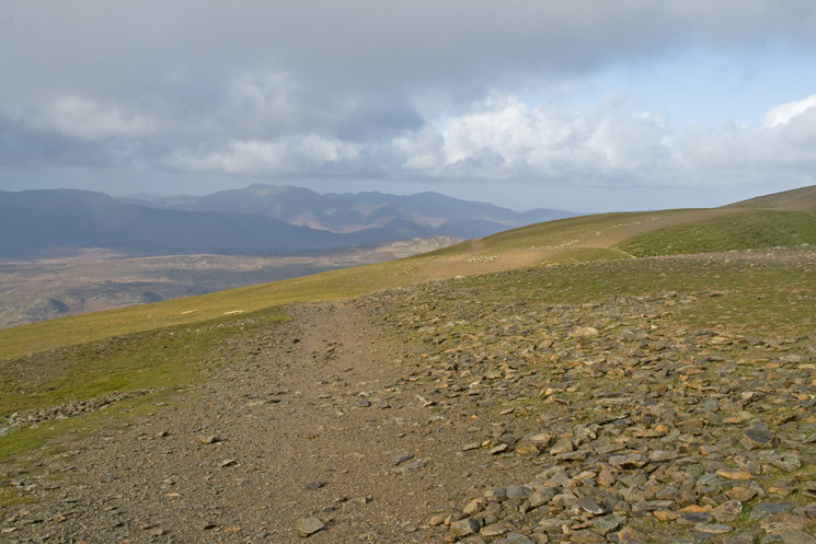 Approaching the col between Helvellyn and Lower Man, the Swirls path is straight ahead with the path to Lower Man on the right