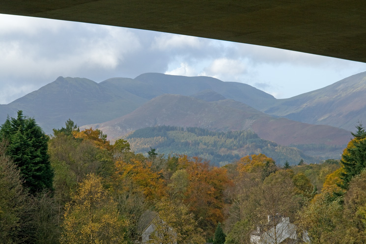 The north western fells seen through one of the arches of the A66 Greta road bridge