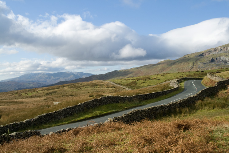 Crossing the Kirkstone Pass road with the Coniston Fells in the distance