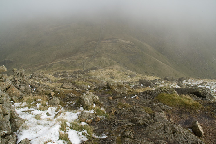 Looking down on Threshthwaite Mouth as we drop out of the cloud