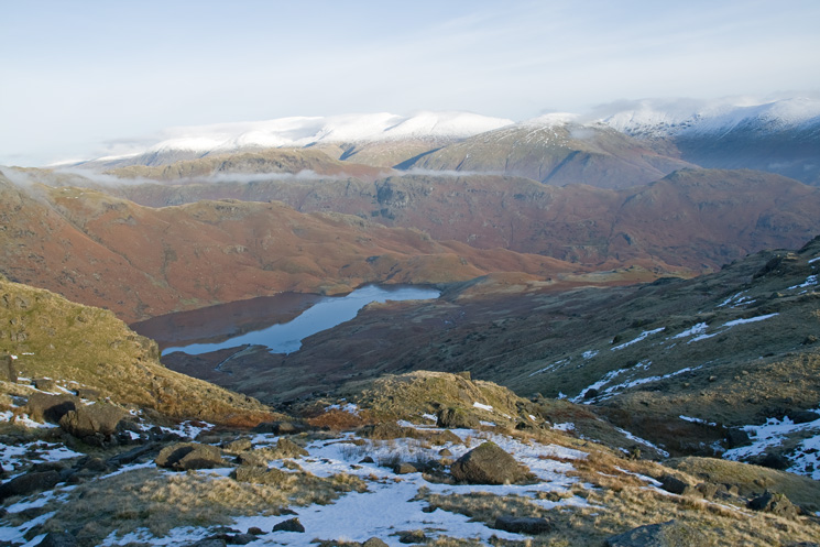 Looking over Easedale Tarn to a snowy Helvellyn range