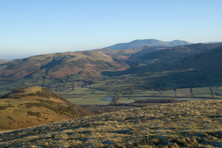 Looking across the Vale of Lorton to the Whinlatter fells with Skiddaw beyond from Smithy Fell