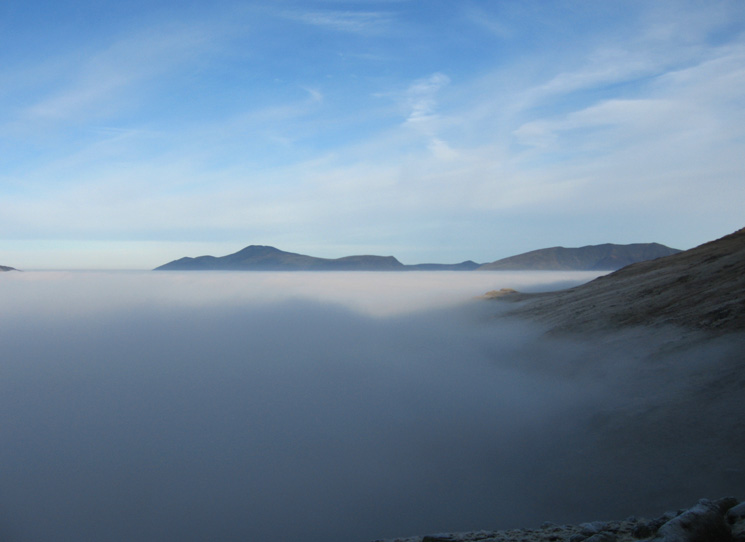 Breaking out of the cloud, looking north to the Skiddaw fells and Blencathra