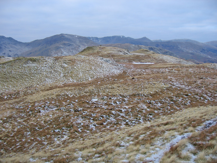 Looking across to Brock Crags summit with St Sunday Crag, Helvellyn and Catstycam in the distance